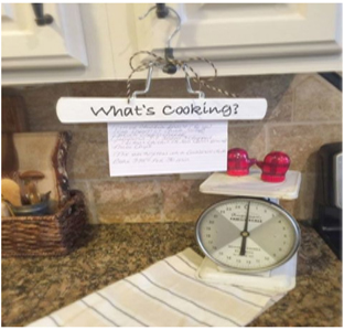 Turn wire hangers into cooking recipe holders